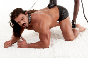 submissive man being dominated by mistress